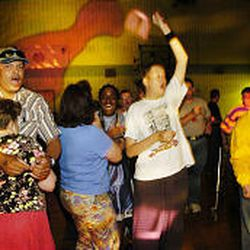 Dancers cheer during a raffle drawing for prizes at a dance at the Copperview Community Center in Midvale, where recreational programs abound for people with disabilities.