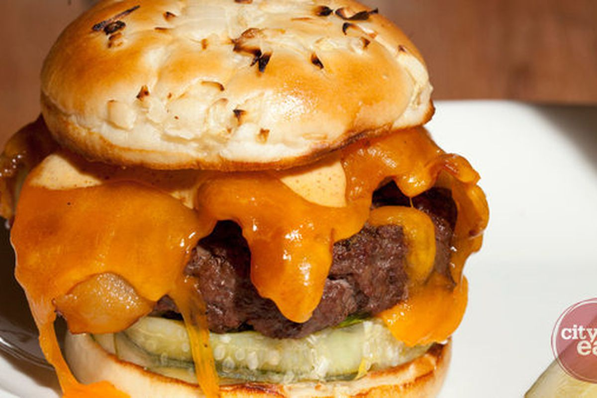 """Good ol' fashioned bacon cheeseburger at <a href=""""http://f.curbed.cc/f/CityEats_EDC_SP_062812_MintwoodPl""""><b>Mintwood Place</b></a>."""