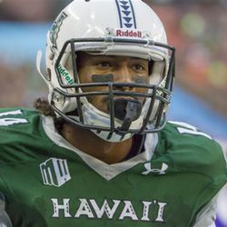 Hawaii wide receiver Marcus Kemp (14) looks on after catching a pass fora touchdown in the first quarter of an NCAA college football game, Saturday, Sept. 10, 2016, in Honolulu. (AP Photo/Eugene Tanner)