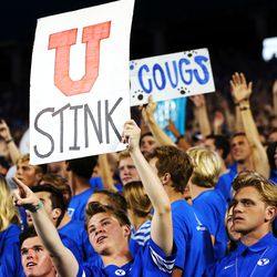 BYU students hold signs as BYU and Utah play an NCAA football game at LaVell Edwards Stadium in Provo on Saturday, Sept. 11, 2021.