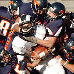 Mountain Crest defenders smother Highland quarterback Thomas Bradley in 4A championship game.