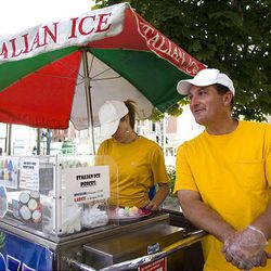 Becka Peterson, 16, and stepfather Gary Ceran wait for customers while selling Italian ice Tuesday in Salt Lake City.