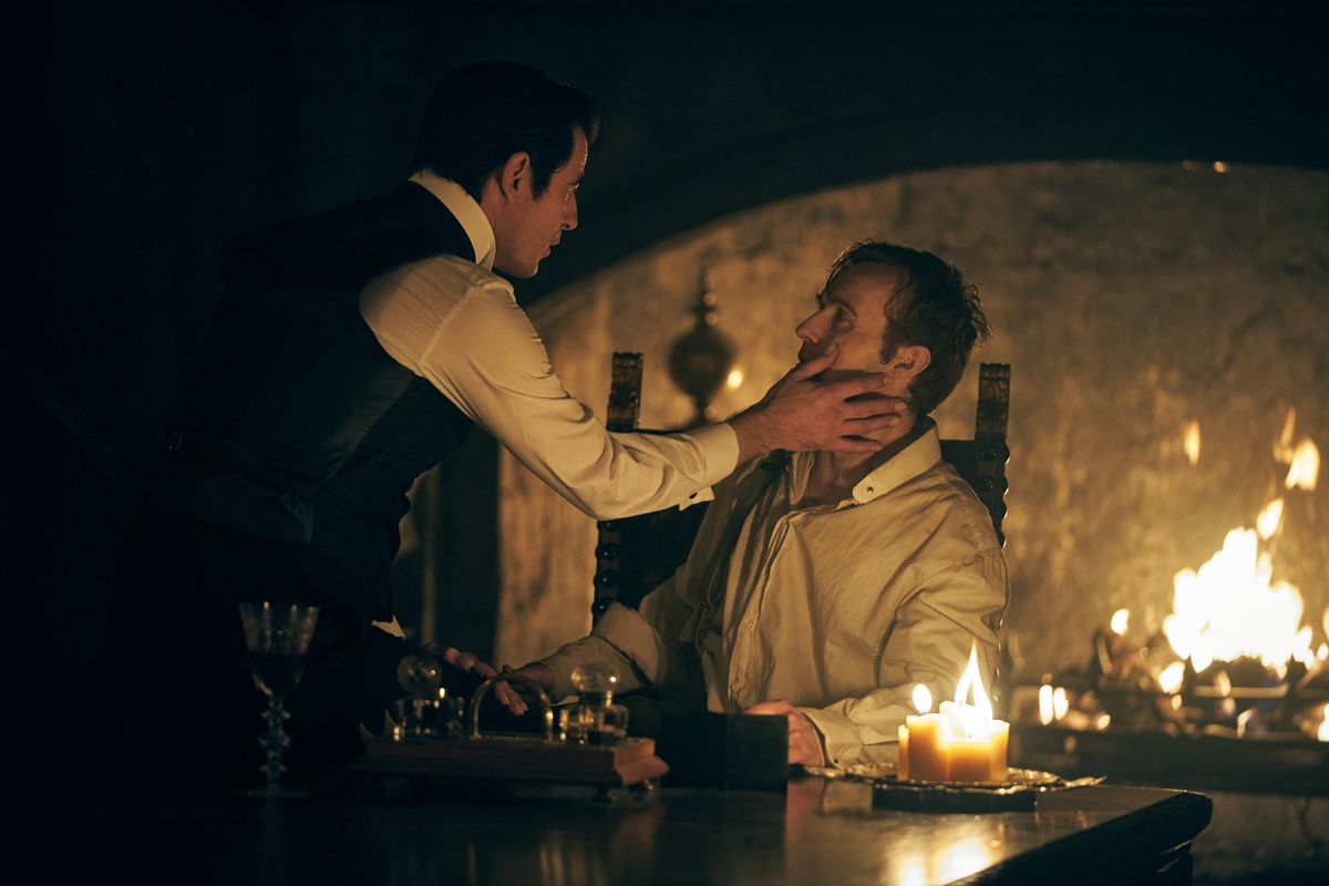 Dracula (Claes Bang) caresses the face of Jonathan Harker (John Heffernan) in a screengrab from Netflix's Dracula