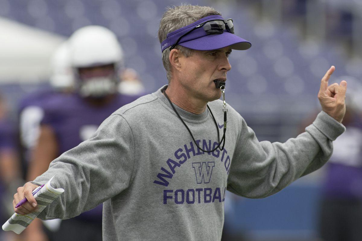 University of Washington head football coach Chris Petersen directs his players during an Aug. 21, 2015, practice at Husky Stadium.
