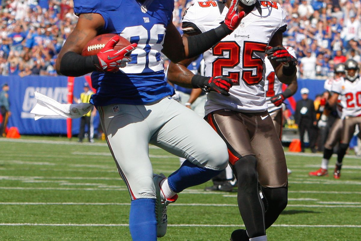 Sep 16, 2012; East Rutherford, NJ, USA;  New York Giants wide receiver Hakeem Nicks (88) scores a touchdown against the Tampa Bay Buccaneers during the first half at MetLife Stadium. Mandatory Credit: Jim O'Connor-US PRESSWIRE