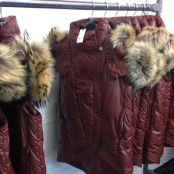 Puffer vest with fur, $425