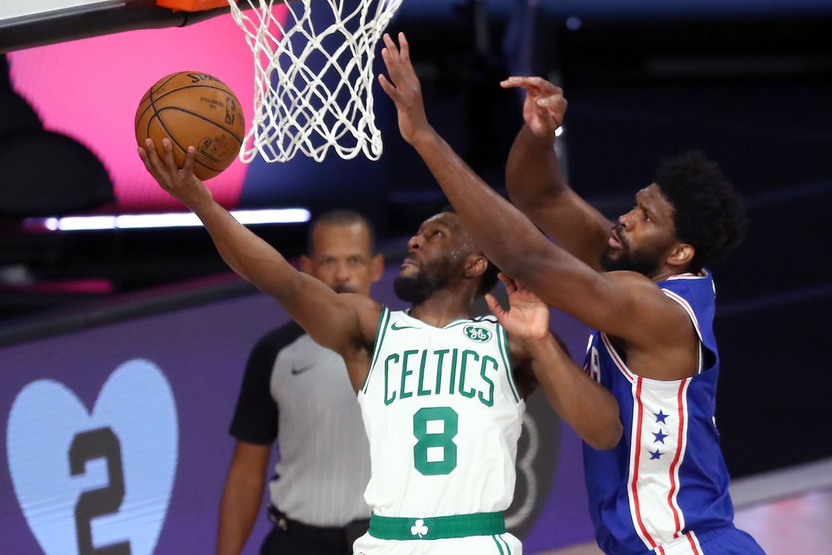 Kemba Walker of the Boston Celtics shoots against Joel Embiid of the Philadelphia 76ers during the first quarter in Game Four of the first round of the playoffs at The Field House at ESPN Wide World Of Sports Complex on August 23, 2020 in Lake Buena Vista, Florida.