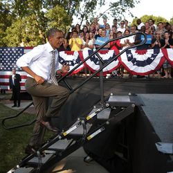 President Barack Obama runs up the stairs before speaking at a campaign event at Morningside College, Saturday, Sept. 1, 2012, in Sioux City, Iowa.