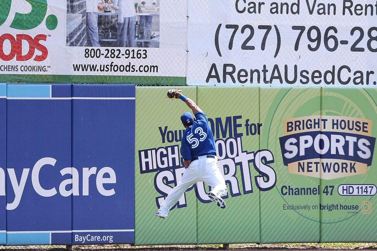 Melky makes a catch at the wall, I doubt he could have jumped that high last year.