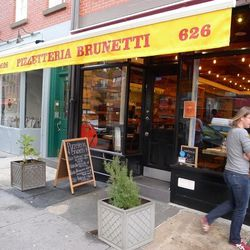 """<a href=""""http://ny.eater.com/archives/2013/11/a_first_look_at_pizzetteria_brunetti.php"""">A First Look: Pizzetteria Brunetti</a>"""