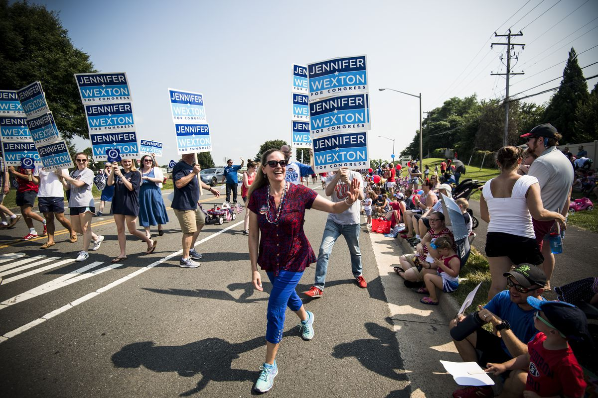 Jennifer Wexton waves to the crowd in Leesburg, Va., as she participates in the Leesburg Independence Day Parade on July 4, 2018.