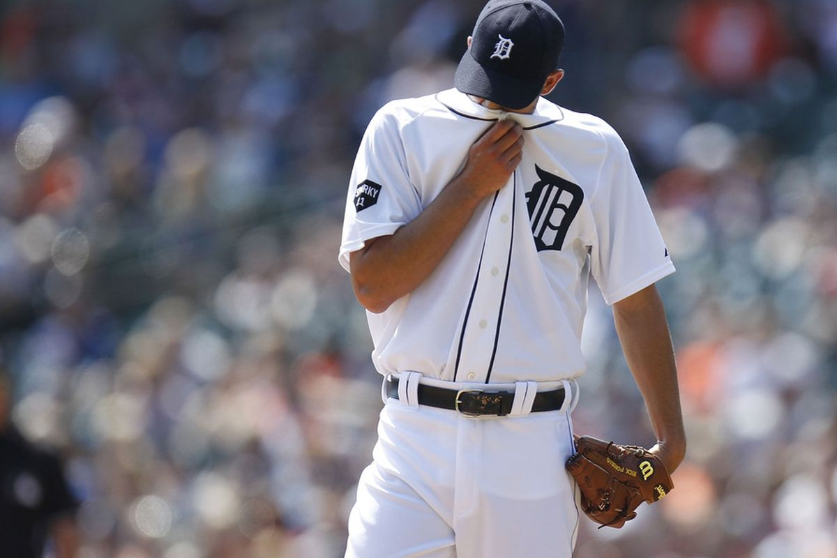 DETROIT, MI - APRIL 10:  Rick Porcello #48 of the Detroit Tigers wipes sweat from his face while playing the Kasas City Royals at Comerica Park on April 10, 2011 in Detroit, Michigan.  (Photo by Gregory Shamus/Getty Images)