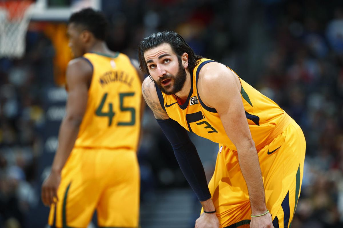 Utah Jazz guard Ricky Rubio, front, of Spain, checks the scoreboard as guard Donovan Mitchell drops back to defend during a break in play against the Denver Nuggets in the second half of an NBA basketball game Tuesday, Dec. 26, 2017, in Denver. The Nugget