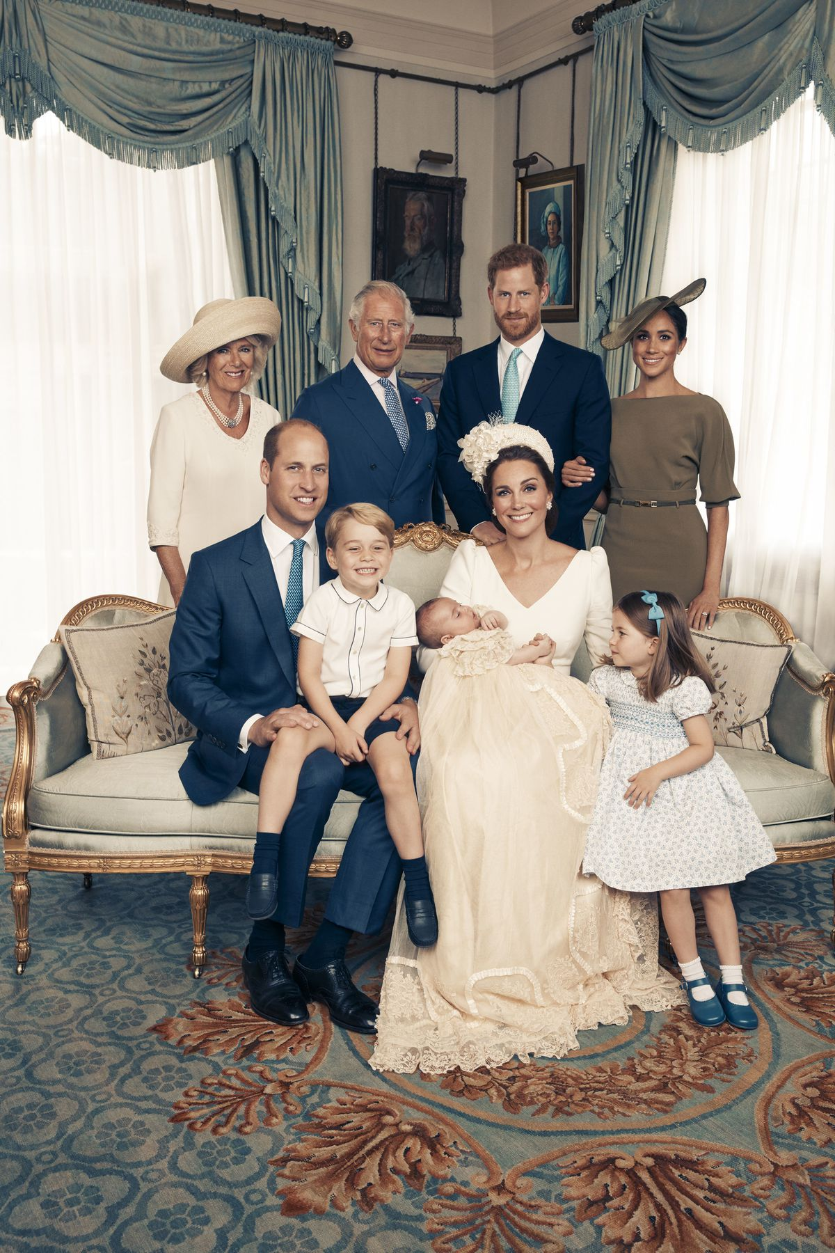 This Monday, July 9, 2018, photo shows an official photograph to mark the christening of Prince Louis at Clarence House, following Prince Louis' baptism, in London. Seated, left to right: Prince William; Prince George; Prince Louis; Kate, the Duchess of C
