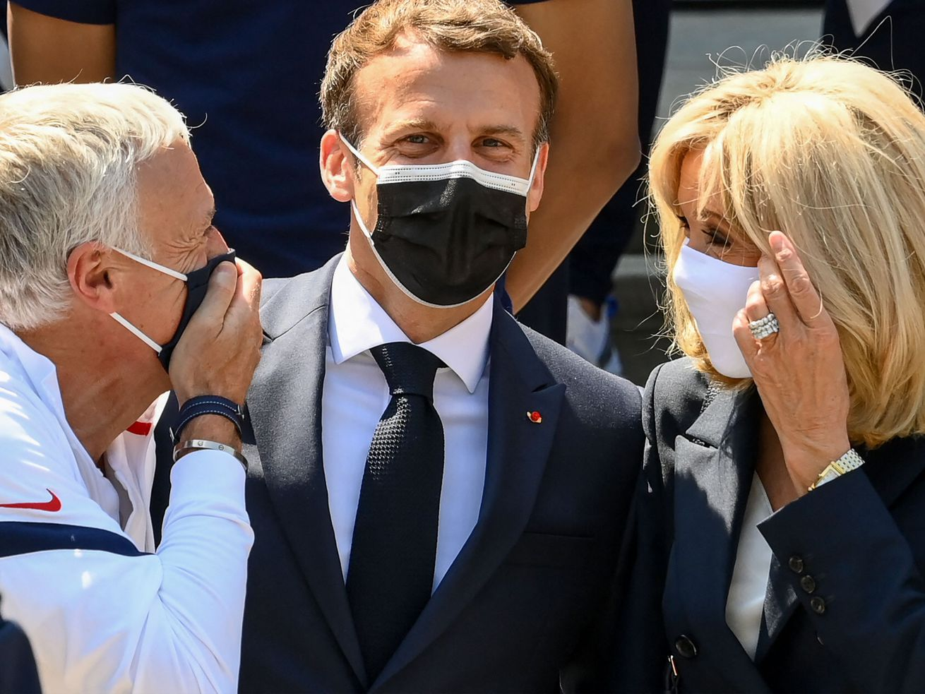 France's coach Didier Deschamps speaks with French President Emmanuel Macron and his wife Brigitte Macron before a lunch with France's players in Clairefontaine-en-Yvelines on June 10, 2021 ahead of the UEFA EURO 2020 football competition.