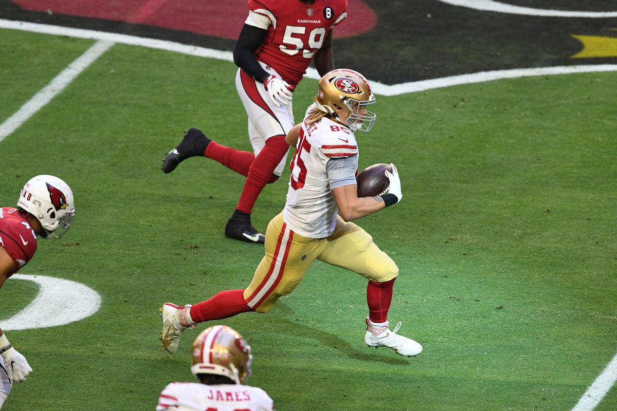 George Kittle #85 of the San Francisco 49ers runs with the ball during a game against the Arizona Cardinals at State Farm Stadium on December 26, 2020 in Glendale, Arizona.