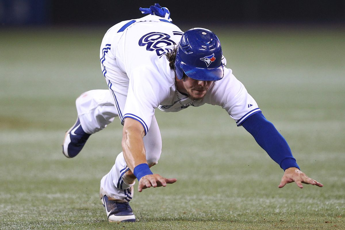 Jul 5, 2012; Toronto, ON, Canada; Toronto Blue Jays center fielder Colby Rasmus (28) stumbles back to the bag against the Kansas City Royals at the Rogers Centre. The Royals beat the Blue Jays 9-6. Mandatory Credit: Tom Szczerbowski-US PRESSWIRE