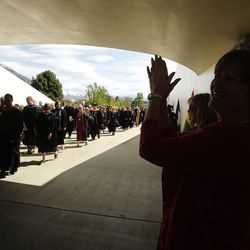 Graduates are applauded during academic procession during BYU Spring 2014 Commencement exercises in Provo Thursday, April 24, 2014.
