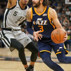 Utah Jazz's Ricky Rubio (3) drives around San Antonio Spurs' Dejounte Murray during the second half of an NBA basketball game Saturday, Feb. 3, 2018, in San Antonio. Utah won 120-111. (AP Photo/Darren Abate)