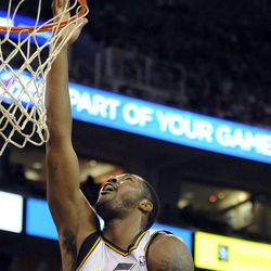 Utah Jazz power forward Derrick Favors (15) goes in for a layup in the second half of a game at the Energy Solutions Arena on Wednesday, October 16, 2013.