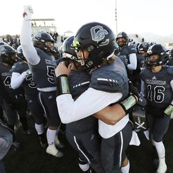Corner Canyon's Jaxson Dart (2), right, celebrates a win over East with teammate Dawson Jacobsen (67) in the 6A football state semifinal game in Eagle Mountain on Thursday, Nov. 12, 2020.