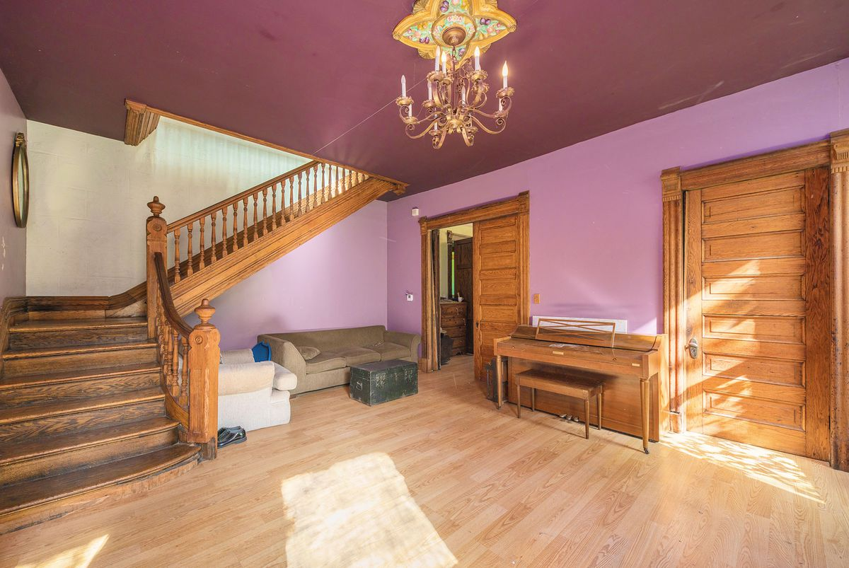 The foyer has wood staircase and pocket doors.