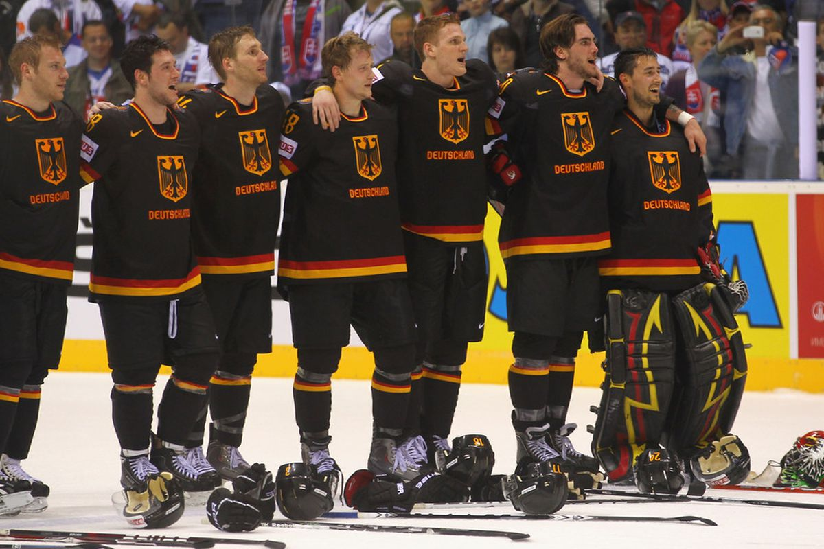 BRATISLAVA, SLOVAKIA - APRIL 29: The team of Germany celebrate after the IIHF World Championship group A match between Germany and Russia at Orange Arena on April 29, 2011 in Bratislava, Slovakia. (Photo by Martin Rose/Bongarts/Getty Images)