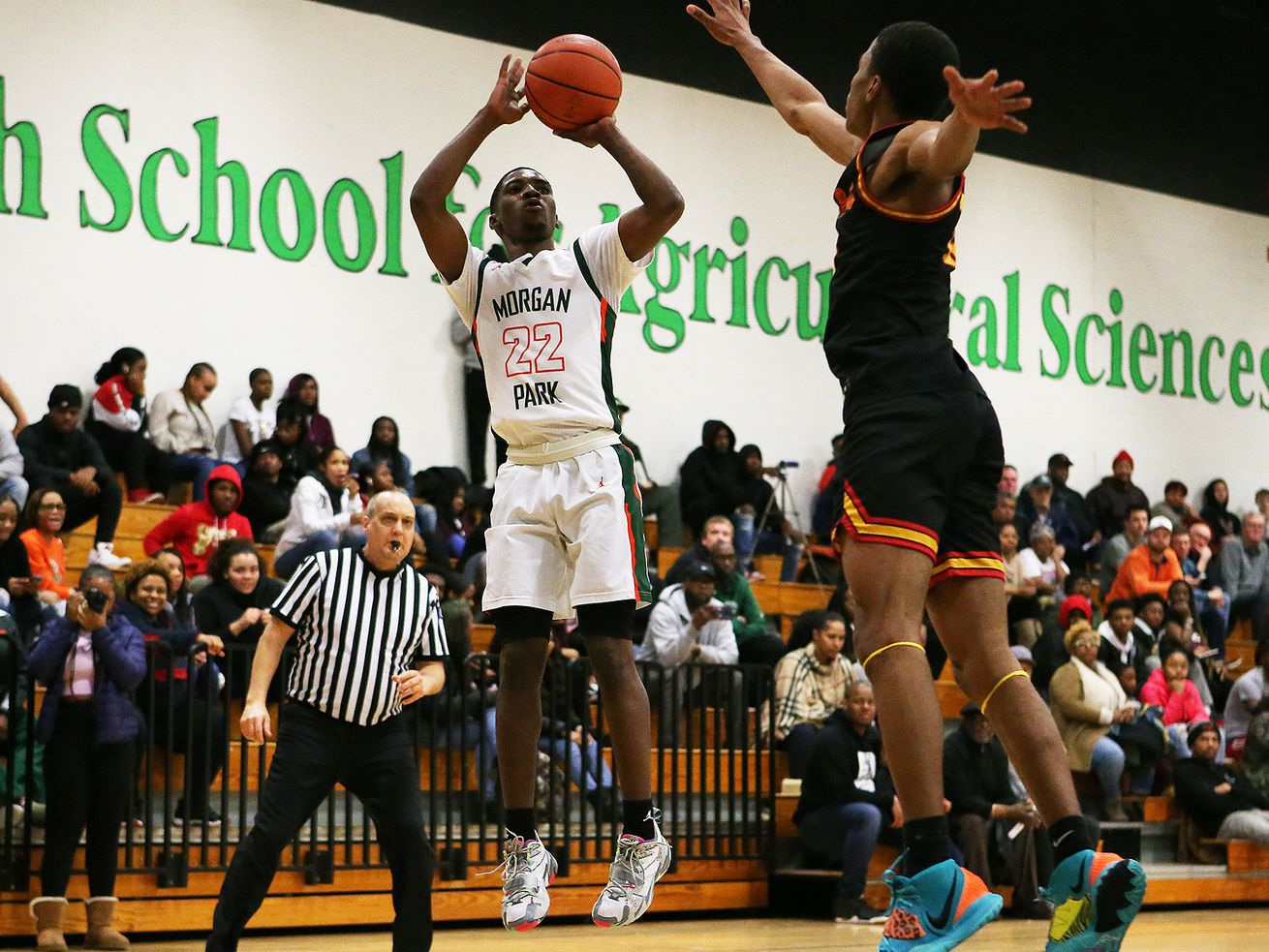 Morgan Park's Marcus Watson, Jr., (22) shoots against Tinley Park.