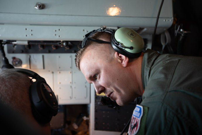 Illinois Air National Guard Master Sgt. Jameson Liggett looks at the route map in the cockpit of a KC-135 Stratotanker over Chicago on Aug. 16, 2018. I Maria de la Guardia/Sun-Times