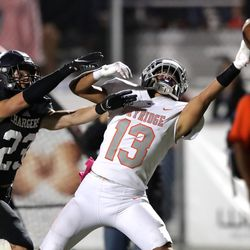 Skyridge's Ezekiel Greco stretches out to bring in a pass as Corner Canyon's Aiden McDonald defends during a high school football game at Corner Canyon in Draper on Friday, Sept. 24, 2021. Corner Canyon won 38-23.