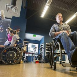 Dustin Shillcox, a paraplegic from Wyoming, shows how he is able to now lift his legs with the aid of electrical stimulation, as he talks about a study that he is part of in Kentucky Monday, April 21, 2014. He is visiting at Neuroworx in South Jordan, where he has received for therapy.