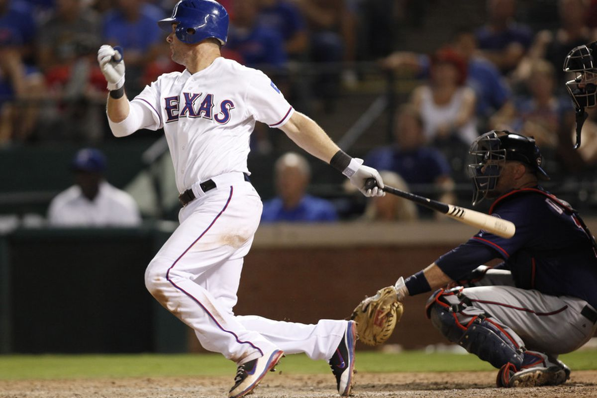 Arlington, TX, USA; Texas Rangers first baseman Michael Young (10) hits a double during the 13th inning of the game against the Minnesota Twins at Rangers Ballpark. The Rangers beat the Twins 4-3.  Mandatory Credit: Tim Heitman-US PRESSWIRE