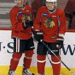 Chicago Blackhawks' Jonathan Toews (19) and Marian Hossa (81), of Slovakia, pause to chat during practice Wednesday, April 11, 2012, in Glendale, Ariz. The Blackhawks and the Phoenix Coyotes are scheduled to play Game 1 of an NHL hockey playoffs Western Conference opening-round series Thursday.