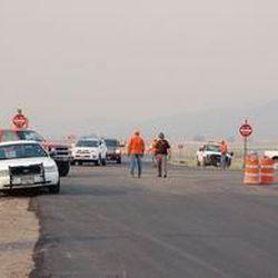 Utah Highway Patrol officers divert traffic from I-15 onto U.S. 50 at Scipio.