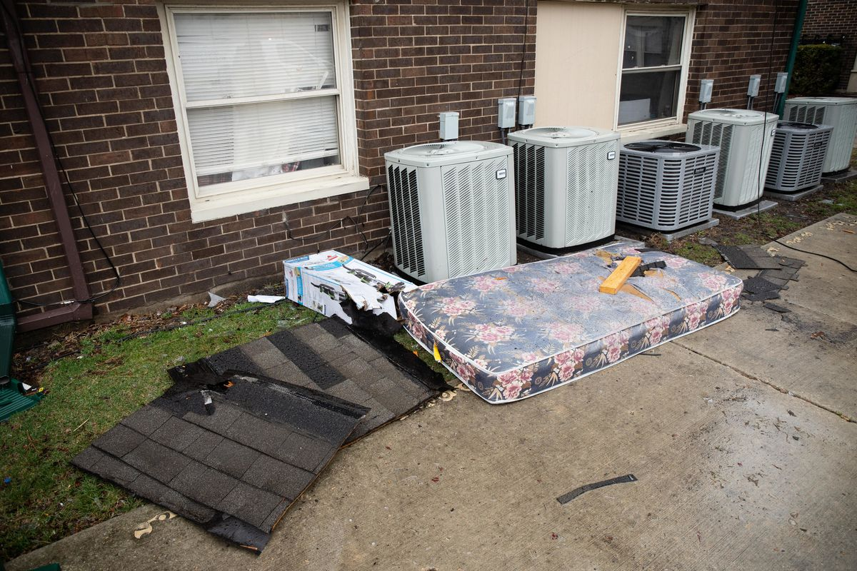 A mattress lies on the ground Thursday morning outside an apartment building in the 6100 block of South Wabash Avenue after a unit caught fire overnight in Washington Park.