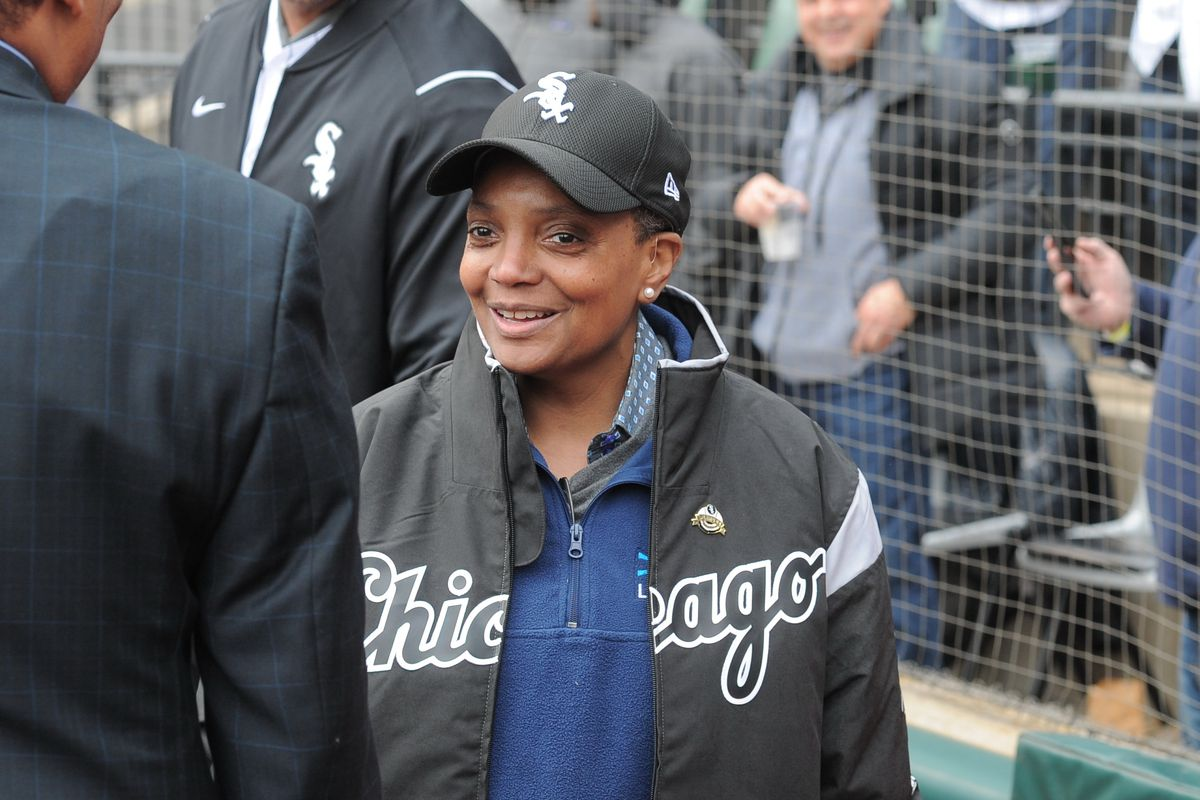 Mayor-Elect Lori Lightfoot stands on the field before throwing out the first pitch for the White Sox home opener against the Mariners at Guaranteed Rate Field on Friday, April 5, 2019.