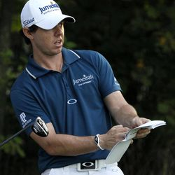 Rory McIlroy of Northern Ireland checks yardage on the 12th tee during the Pro-Am tournament of the BMW Championship PGA golf tournament at Crooked Stick Golf Club in Carmel, Ind., Wednesday, Sept. 5, 2012.