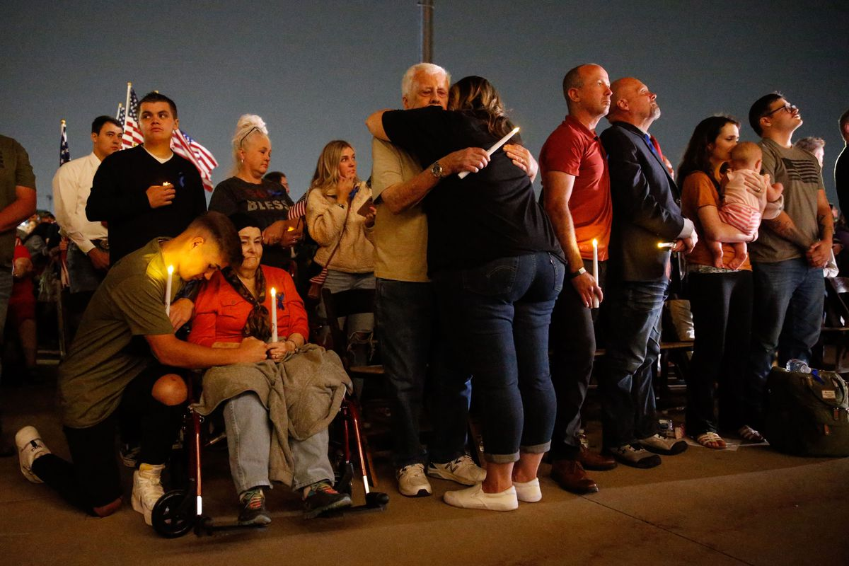 Family members attend a vigil to honor the life and service of Marine Staff Sgt. Taylor Hoover at the Capitol in Salt Lake City on Sunday, Aug. 29, 2021. Hoover was one of the 13 U.S. service members killed by the terrorist attack at Hamid Karzai International Airport in Kabul, Afghanistan.
