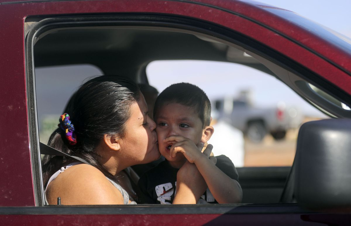 Tyana Phillips kisses son Kyle Wagner after they both were tested for COVID-19 outside of the Monument Valley Health Center in Oljato-Monument Valley, San Jan County, on Friday, April 17, 2020.