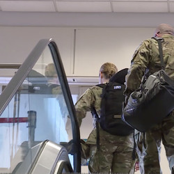 Hill Air Force Base medics Katherine Trout and Jimmy Jones head to their gate at the Salt Lake City International Airport on Sunday, April 5, 2020, to help New York City after being called up to fight COVID-19.