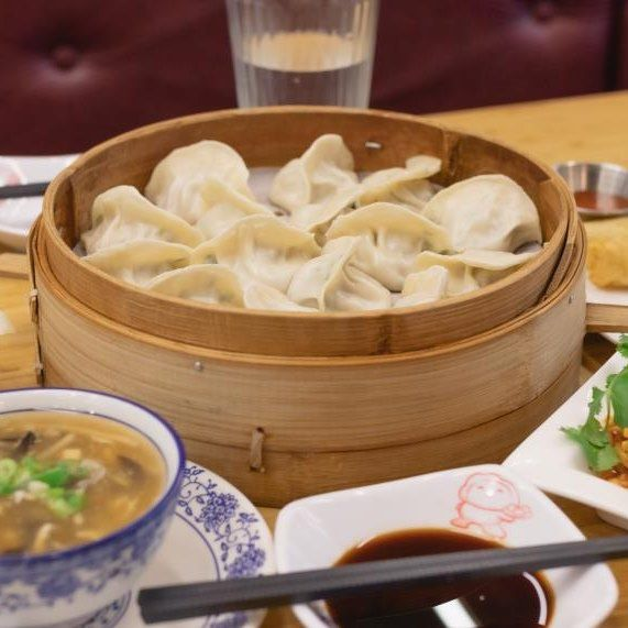 table with dumplings and soup