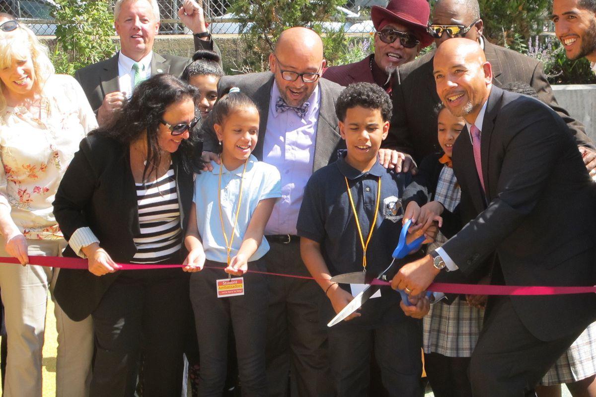 Chancellor Betty Rosa and Bronx Borough President Ruben Diaz Jr. cut the ribbon for a new playground at P.S. 55/Success Academy Bronx 2.