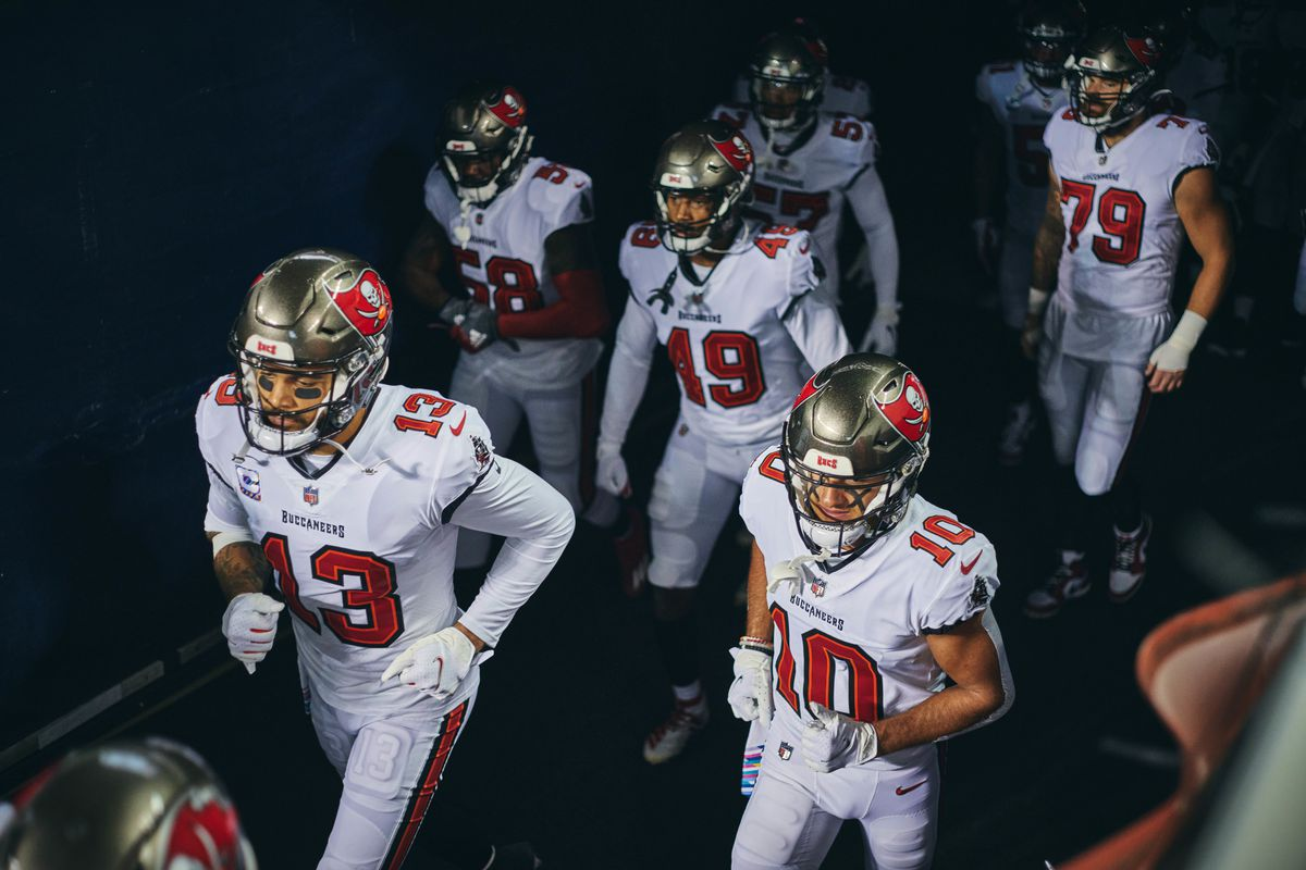 Tampa Bay Buccaneers Wide Receiver Mike Evans (13) and Tampa Bay Buccaneers Wide Receiver Scotty Miller (10) jog out the the field prior to game action for a NFL game between the Chicago Bears and the Tampa Bay Buccaneers on October 8th, 2020, at Soldier Field in Chicago, IL.