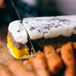 A take on a traditional terrine, Dodds' vegetarian version uses ash-dusted goat cheese from Latte Da Creamery, mushroom duxelle, and butternut squash.
