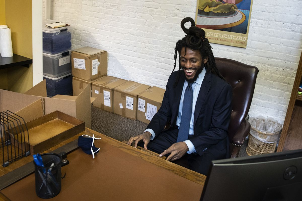 State Sen. Mike Simmons looks in his desk drawers to make sure his predecessor didn't forget anything as he sits at his desk for the first time at the district office in the Edgewater neighborhood on the North Side on Thursday.