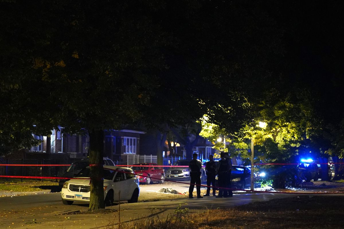 Police investigate the scene where a man was shot dead, in the 700 block of North St. Louis Avenue, Sept. 16, 2019, in Garfield Park.