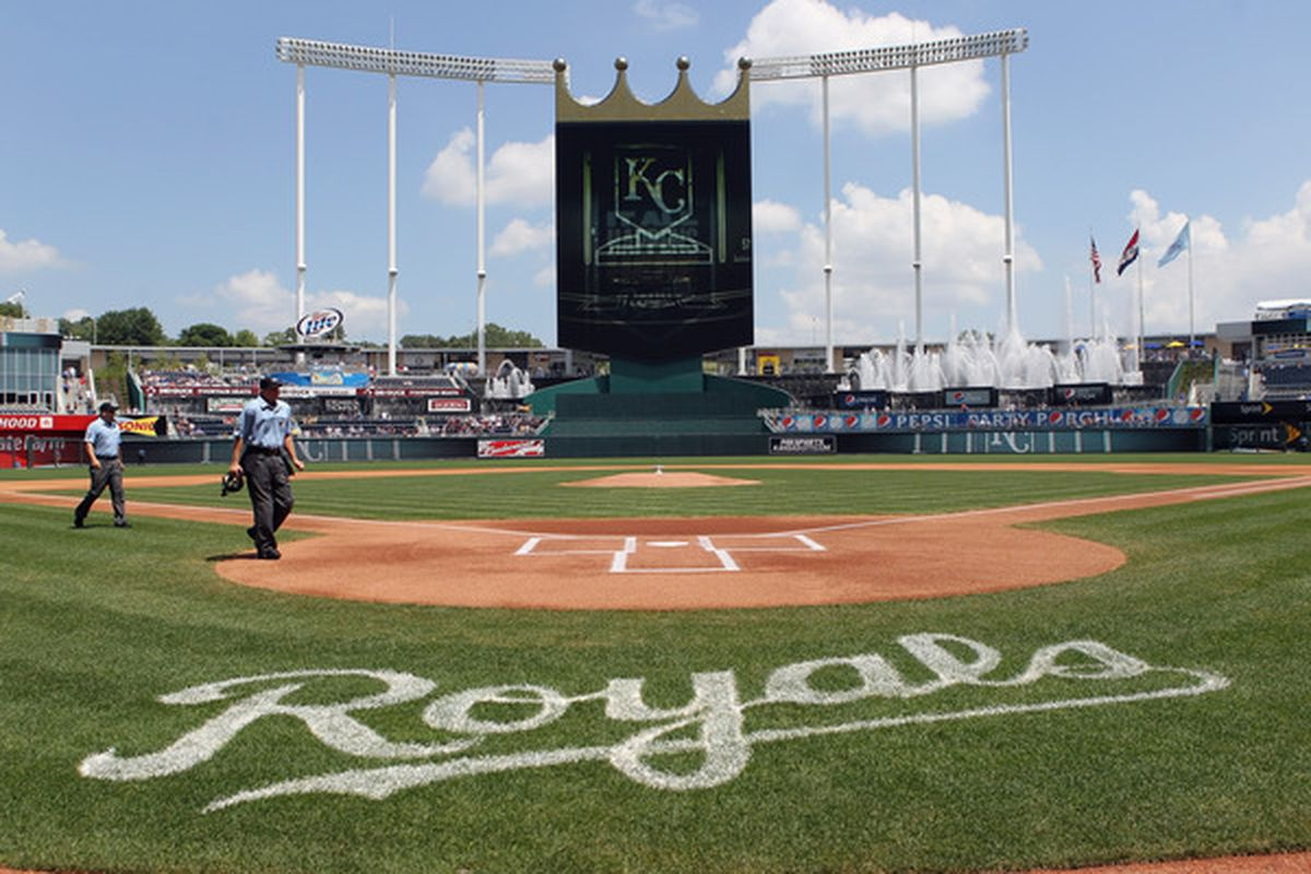 KANSAS CITY MO - JULY 28:  Umpires walk onto the filed just prior to the start of the game between the Minnesota Twins and the Kansas City Royals on July 28 2010 at Kauffman Stadium in Kansas City Missouri.  (Photo by Jamie Squire/Getty Images)