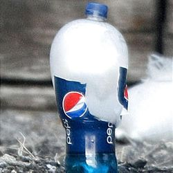 A plastic Pepsi bottle bulges and prepares to explode after being turned into an acid bomb during a demonstration by the Salt Lake Police Department's Bomb Squad Tuesday in Salt Lake City. The demonstration was aimed at raising awareness of the dangers associated with homemade dry-ice and chemical bombs.