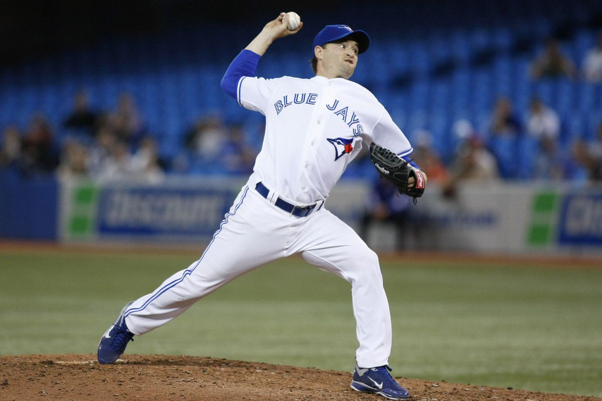April 13, 2012; Toronto, ON, CANADA; Toronto Blue Jays relief pitcher Jason Frasor (54) pitches against the Baltimore Orioles at the Rogers Centre. Baltimore defeated Toronto 7-5. Mandatory Credit: John E. Sokolowski-US PRESSWIRE