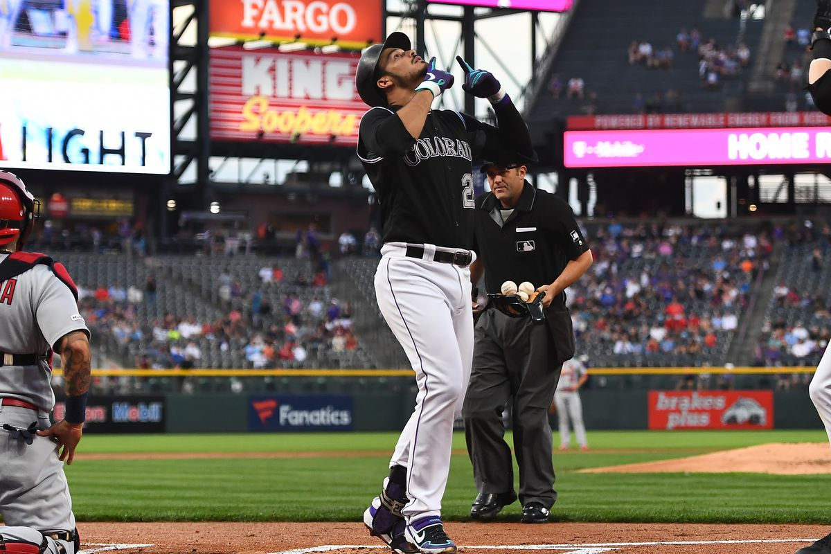 Colorado Rockies third baseman Nolan Arenado celebrates his two run home run in the first inning against the St. Louis Cardinals at Coors Field.